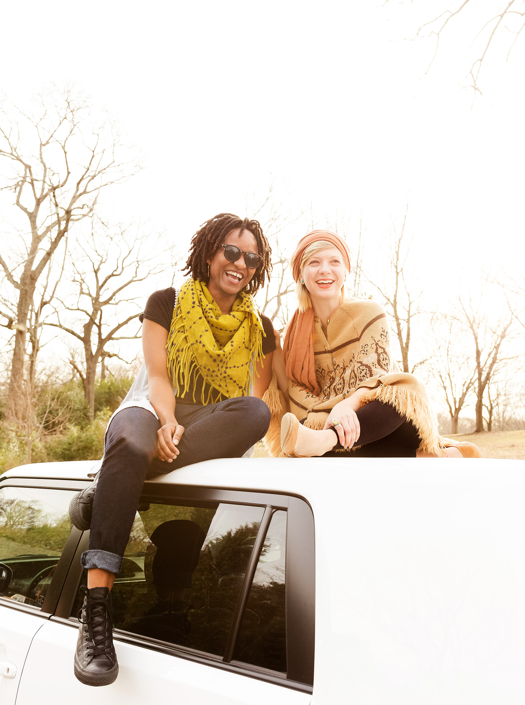 Young Women Sitting on a Car
